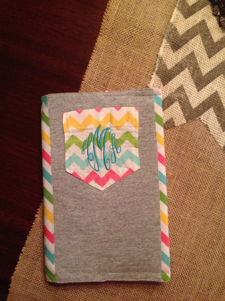 Make a book cover with monogrammed pockets